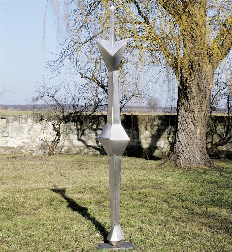 Sonnenanbeter Kleinere Variante zur 18 m großen Skulptur, die auf der Weltausstellung 1964 in New York gezeigt wurde.